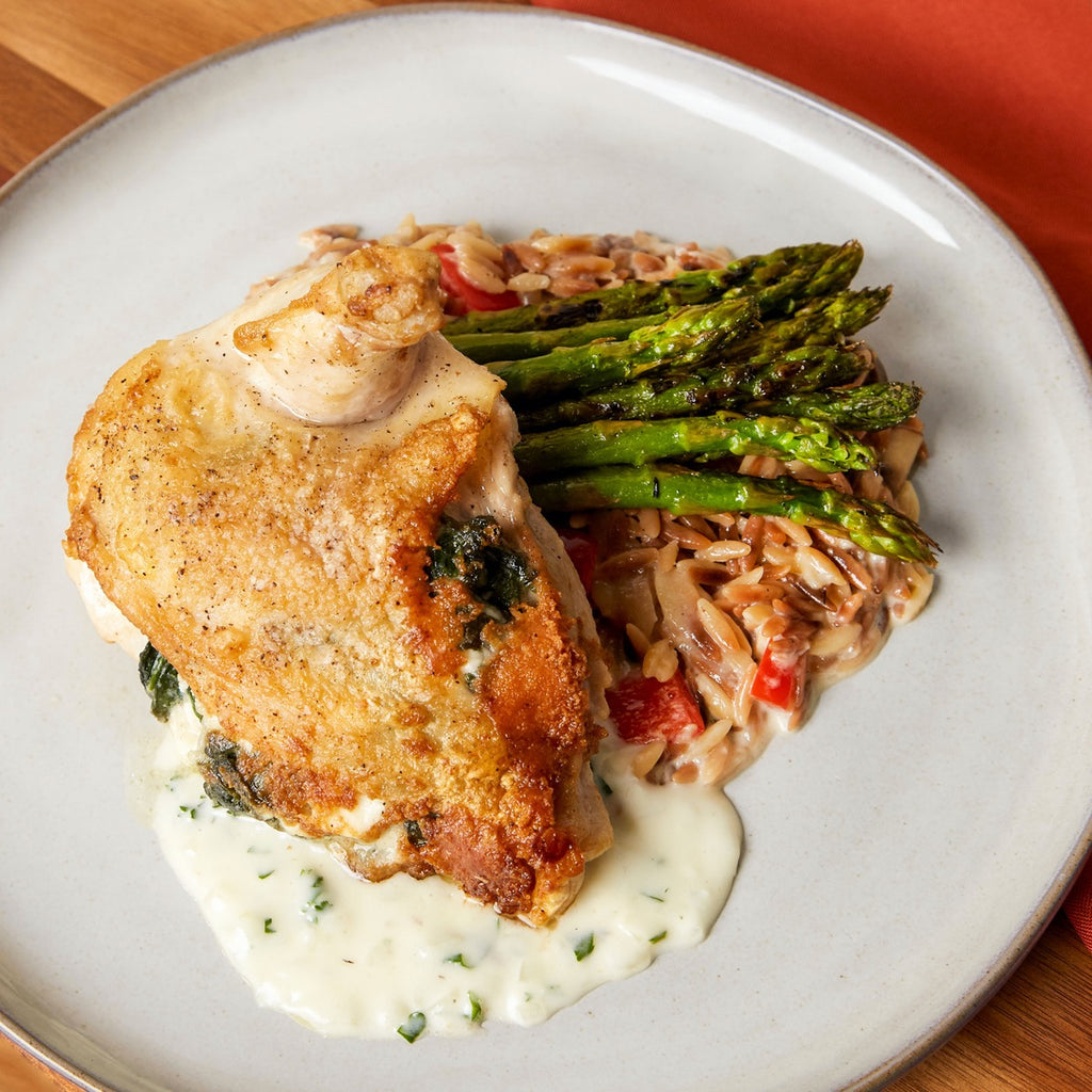 Mediterranean Stuffed Chicken with Orzo and Charred Asparagus