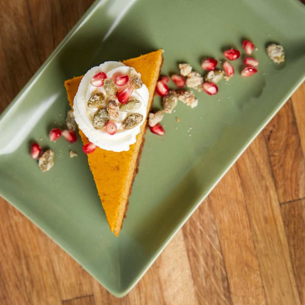 Rich Pumpkin Chai Cheesecake with Pomegranate