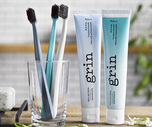 Grin Charcoal-Infused Biodegradable Brush - Four Colors