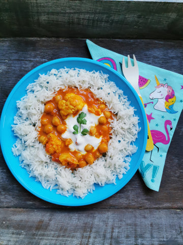 Child's portion of quick chickpea curry with cauliflower, basmati rice, greek yogurt and fresh coriander