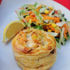 Individual Cheesy Salmon & Potato Pies, served with a lemon wedge and side salad