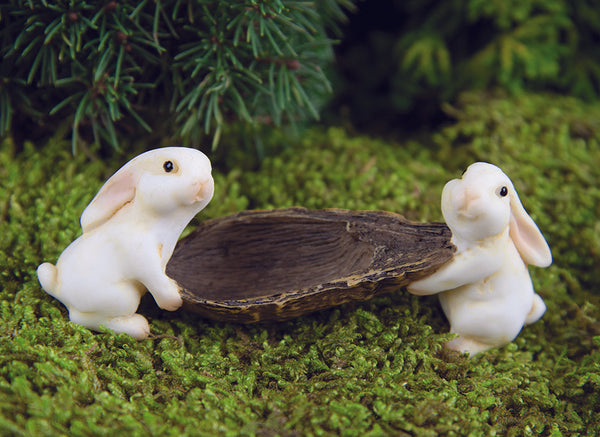 Bunnies Carrying a Pod