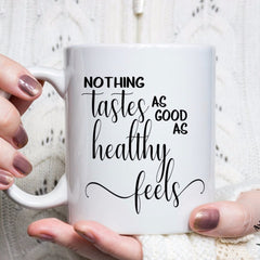 Nothing tastes as good as healthy feels, inspirational coffee mug