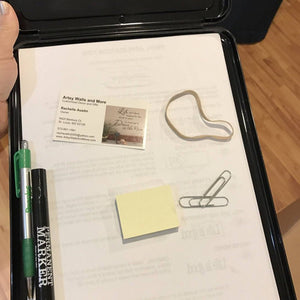 Inside of the Black Storage Clipboard with convenient storage for pens and more