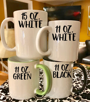mug sizes, 15 oz white mug, 11 oz white mug, 11 oz green mug, and 11 oz black handle mug