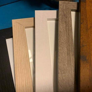 5 wooden frame choices: black, blonde, white, gray, and honey