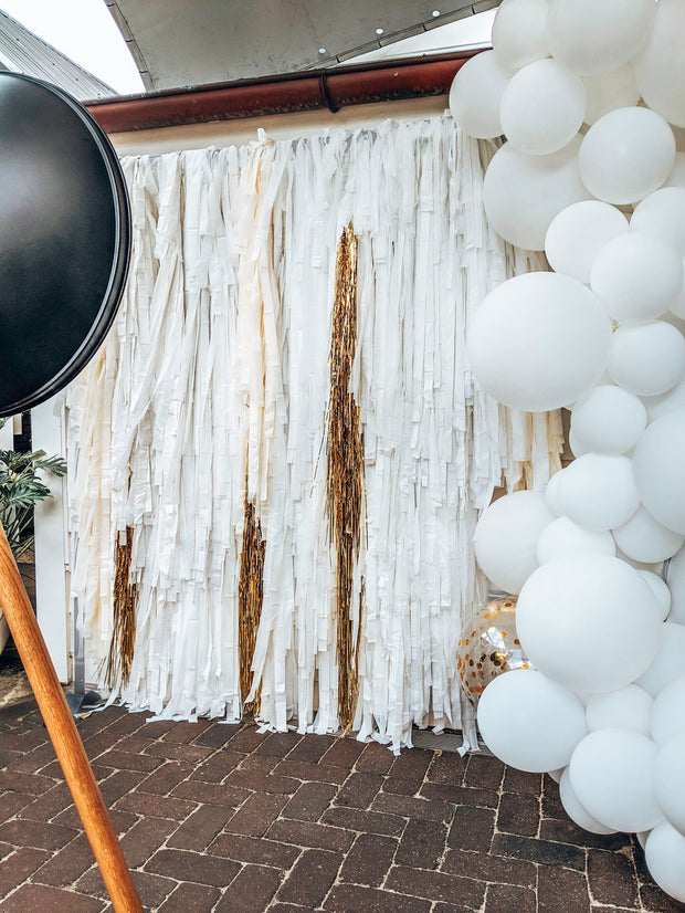 white tassel backdrop