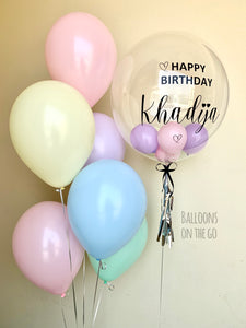 Customized bubble balloon with pastel bouquet