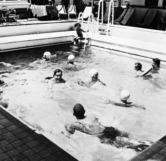 Passengers in the pool on board ORONSAY