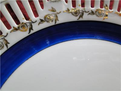 White Reticulated Plate w/ Gold Flowers, Blue Band, Lady in Center, 10 1/2""