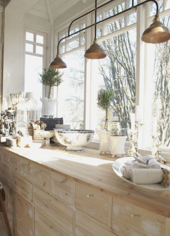 swedish kitchen with copper lights