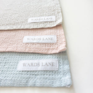 pastel blue, pink and grey wash cloths