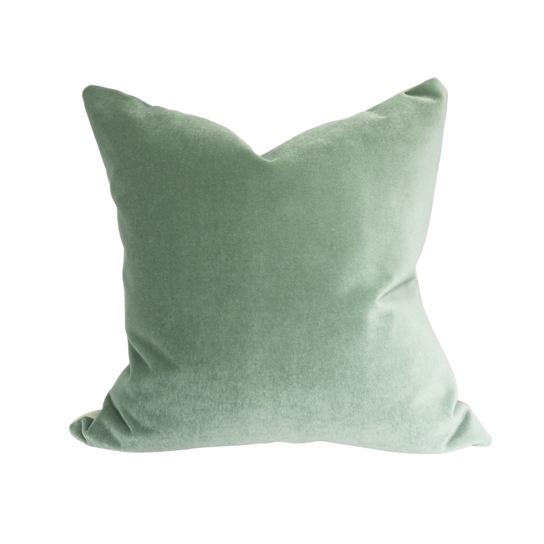This is a throw pillow.  The designer fabric consists of velvet and 100%  Belgian linen.  The colours represent the fall and winter and Christmas holidays of a sage green.  The back is neutral linen.  There is an invisible Zipper.  Perfect addition to any couch, chair, bed as a decorate luxury pillow. Fabric Brand is Schumacher, Romo and mark alexander.  The Style is traditional, modern farmhouse and coastal Hampton's
