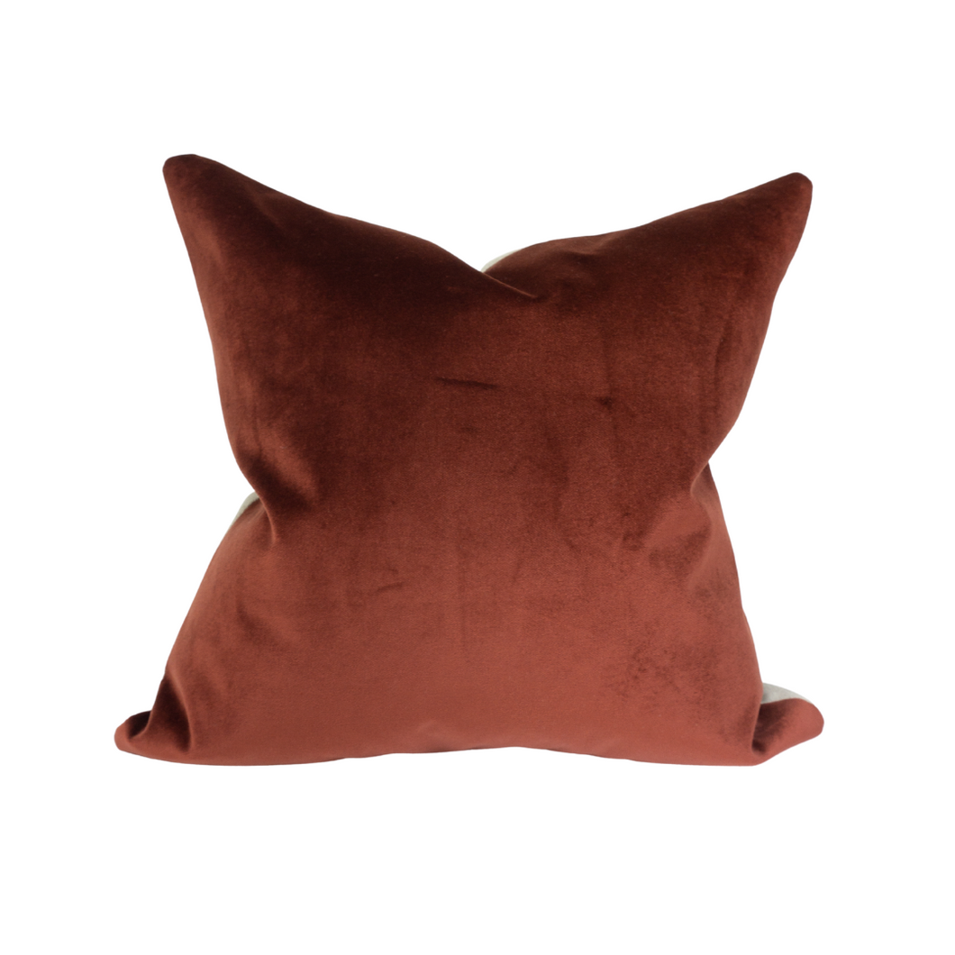 This is a throw pillow.  The designer fabric consists of velvet and 100%  Belgian linen.  The colours represent the fall and winter and Christmas holidays of a sangria red, burnt orange.  The back is neutral beige linen.  There is an invisible Zipper and it is stain repellant.  Perfect addition to any couch, chair, bed as a decorate luxury pillow. Fabric Brand is Schumacher, Romo and mark alexander.  The Style is traditional, modern farmhouse and coastal Hampton's