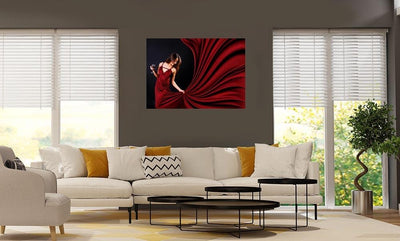 woman in red holding glass of red wine poster