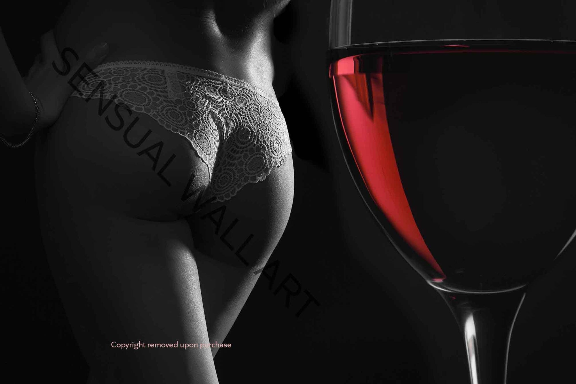 Womans beautiful derriere  and a glass of red wine