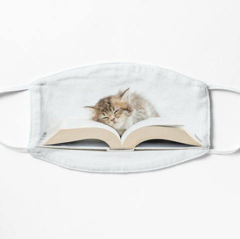Adorable kitten on book, cat on book face mask