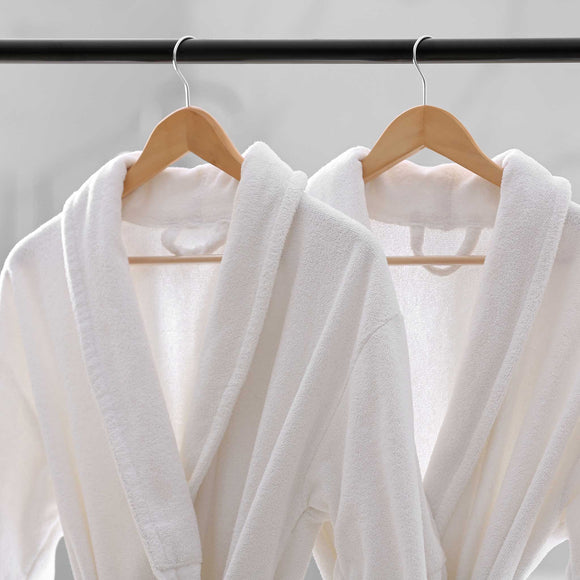 White 450gsm cotton towelling bathrobe for hotel and spa industry. Shop at SR Amenities, www.sramenities.co.za
