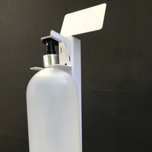 Close-up of the hands free hand sanitizer stand and dispenser showed with spray bottle