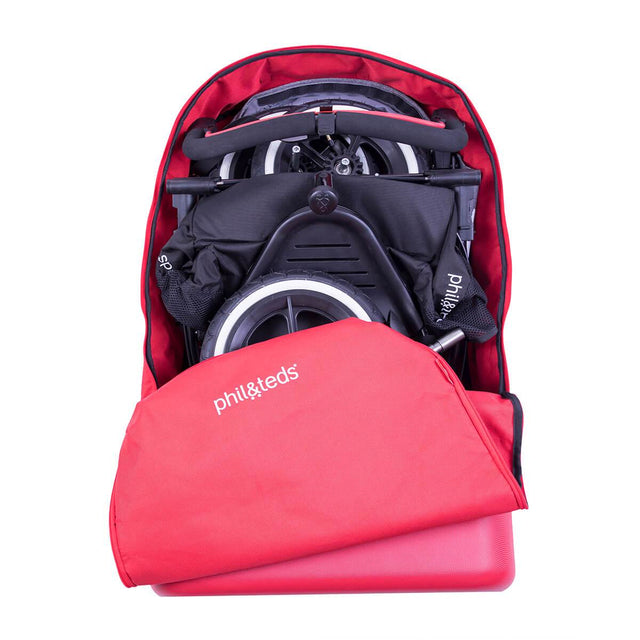 phil&teds travel bag loaded with buggy and zipped open top view_red