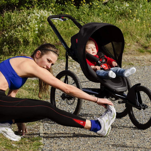 phil&teds sub 4 jogging stroller with athlete stretching_black