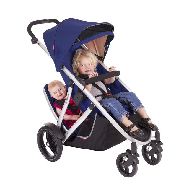 phil&teds verve buggy with double kit in cobalt with 2 toddlers seated 3/4 view_cobalt
