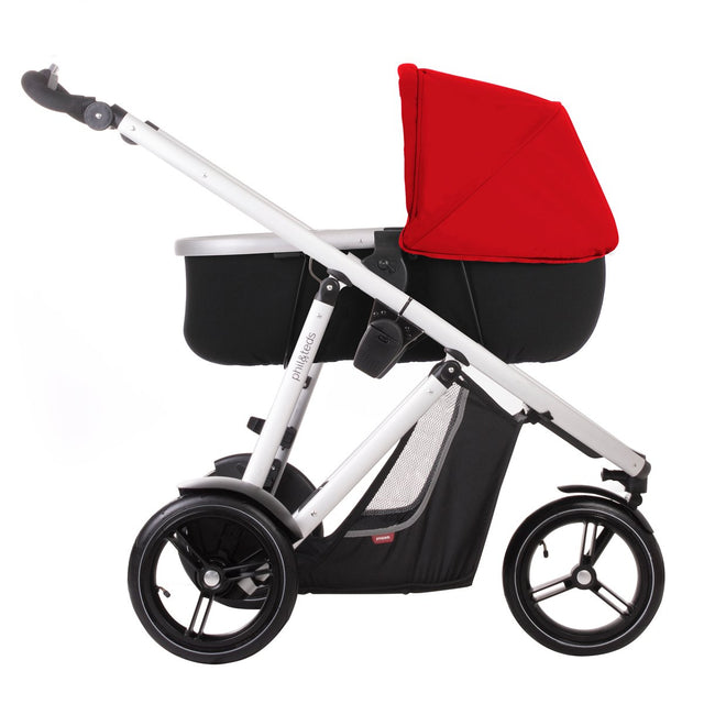 phil&teds vibe & verve carrycot with red sunhood on buggy side view_red