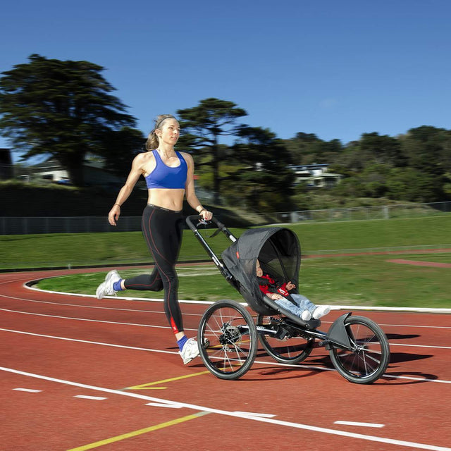 girl running with baby in phil&teds sub 4 running buggy_black