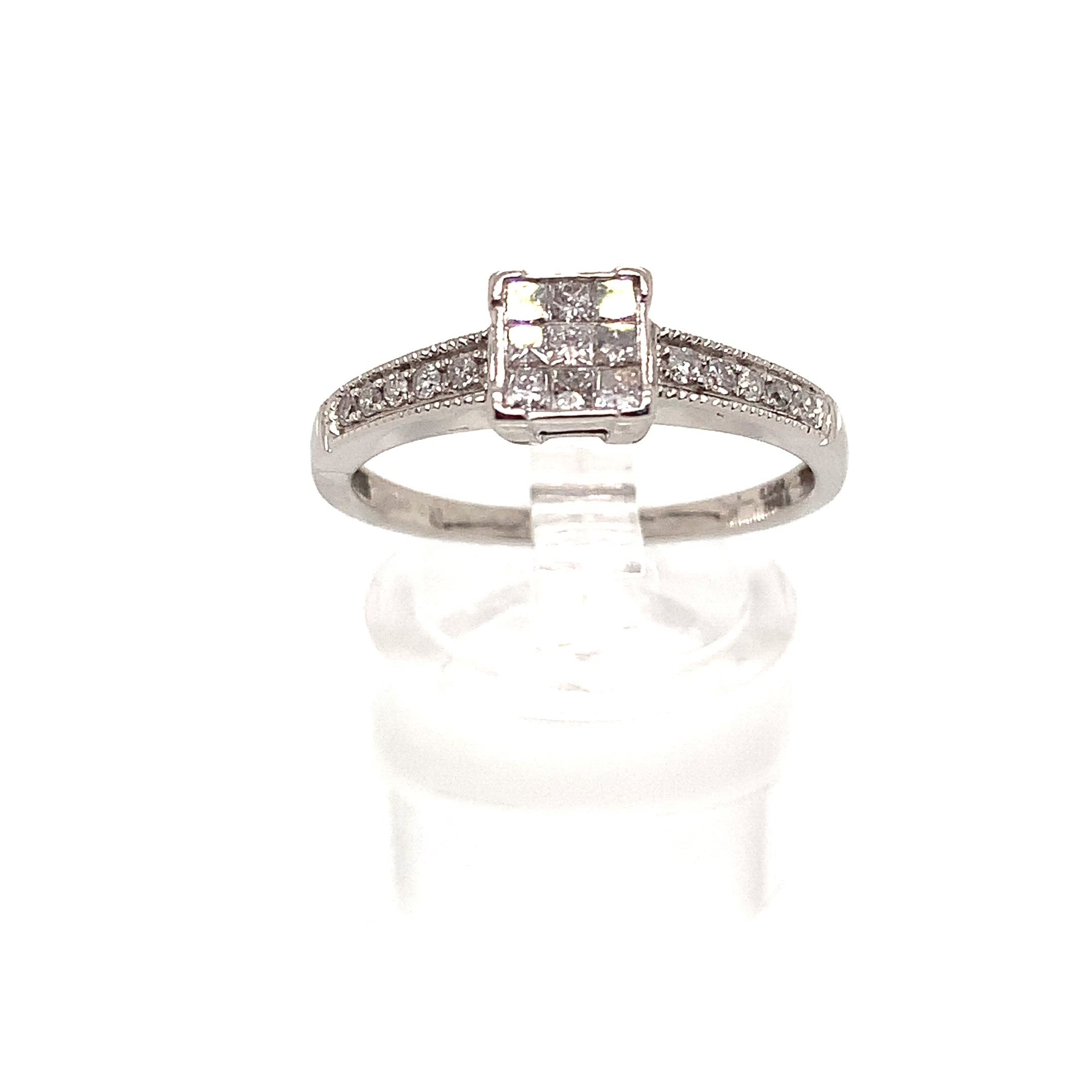 18ct White Invisible Set Diamond Solitaire Style Ring with Diamond Set shoulders 0.33ct