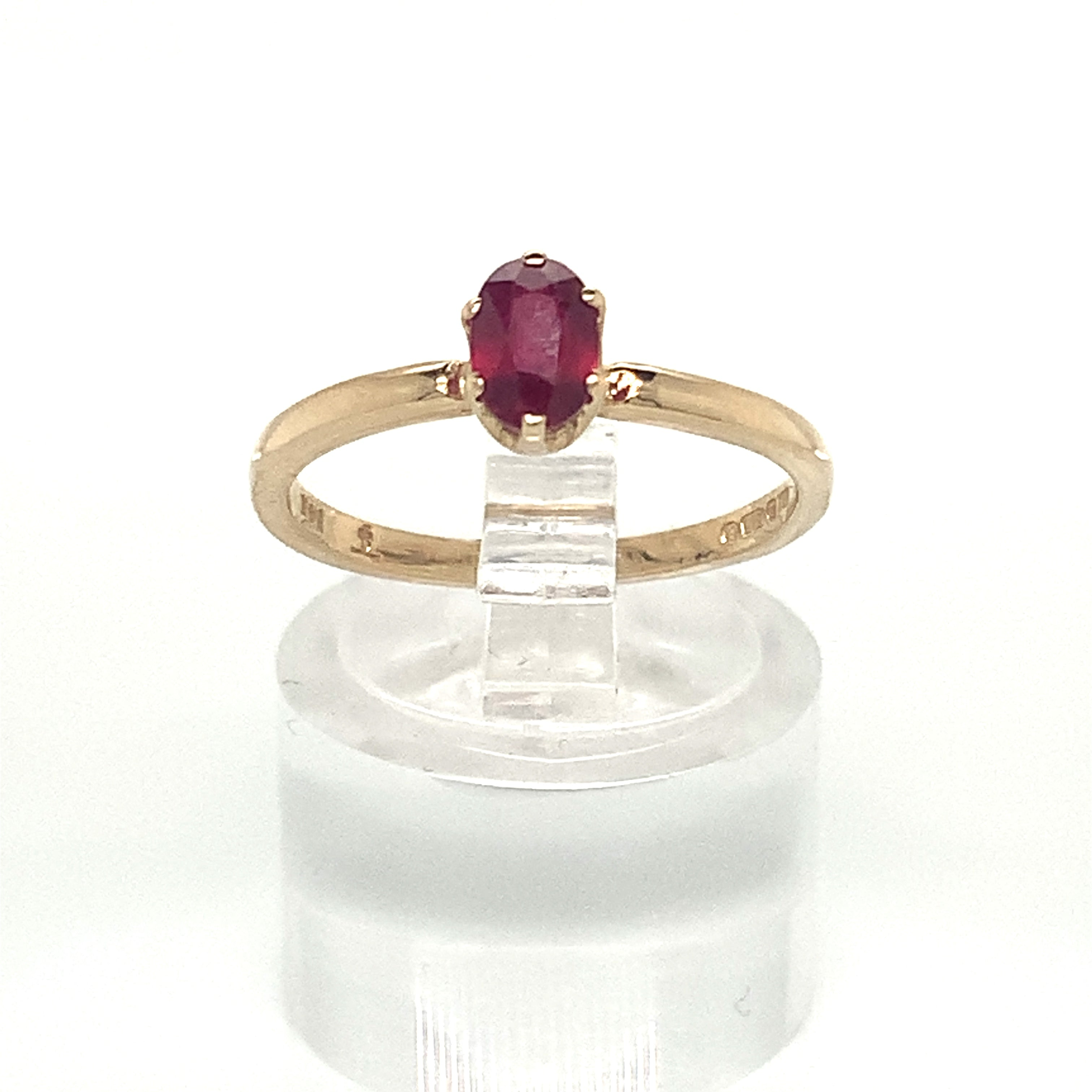 Oval Cut Ruby Solitaire Ring