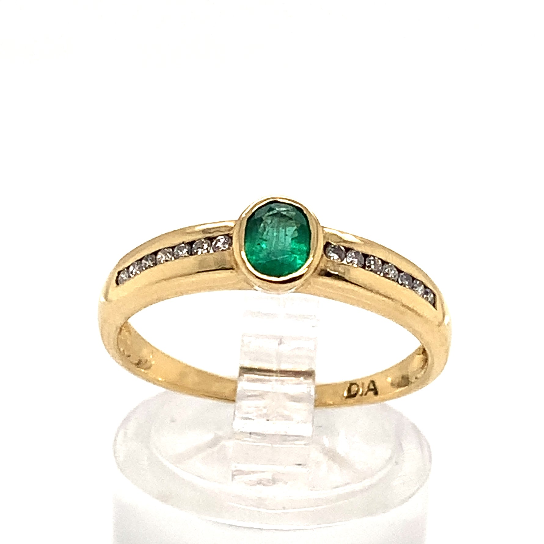 Emerald Ring with Diamond set shoulders