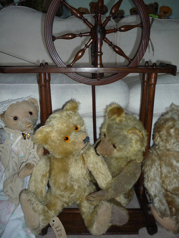 (1) A group of Teddies with their new spinning wheel!