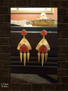 Orange coloured stone earring with three spikes