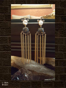 White and black stone long chain earrings in gold and black polish