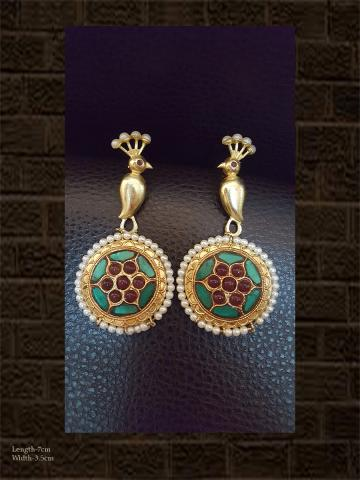 Unique peacock design green enamel and red stone earring