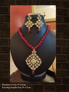 Rhombus shaped kundan and AD pendant set in ruby string