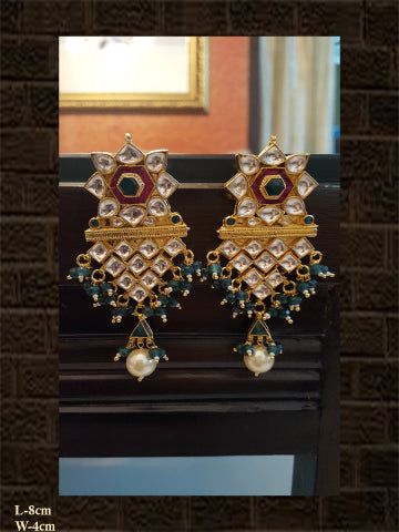 Unique design kundan earring in rani and green