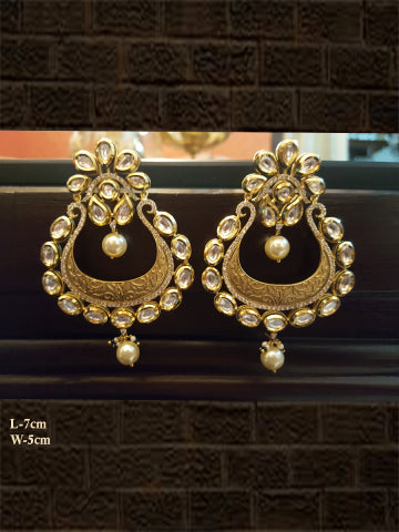Matt finish intricate carving kundan and AD earring