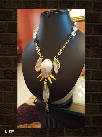 Shell designed neckpiece with white and amethyst stones