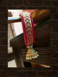 Intricate design on red acrylic kada with kundan flower and jhoomki on the other side - Odara Jewellery