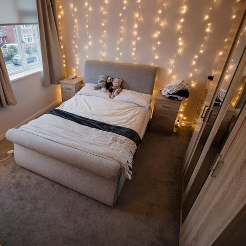 starlit curtain on the wall in a bedroom
