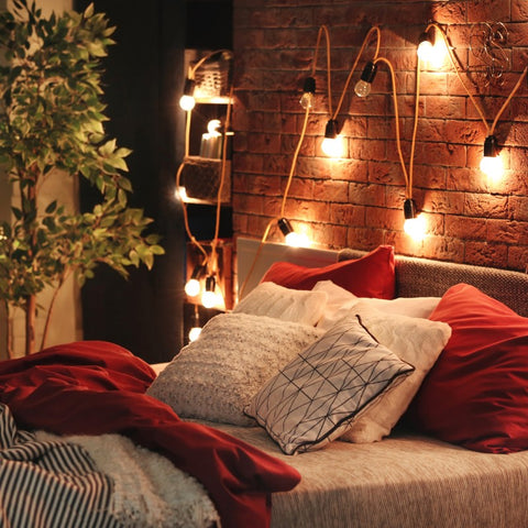 string lights on the wall in a bedroom