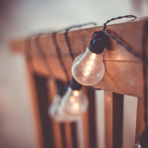 string lights surrounding a wooden banister