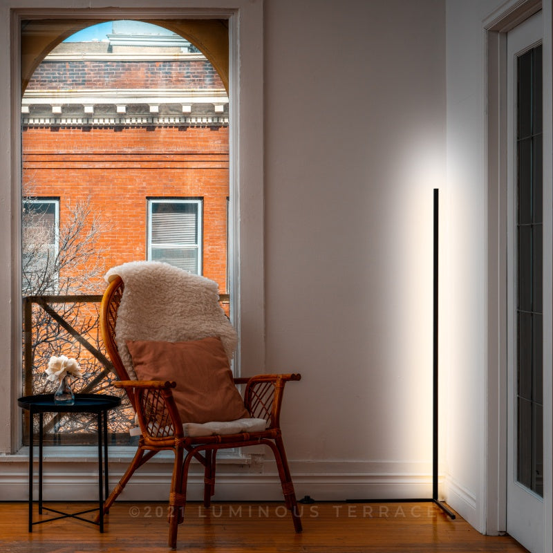 Dawn Ambiance LED Floor Lamp black by the window Luminous Terrace