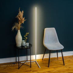 Dawn Ambiance LED Floor Lamp beside a chair