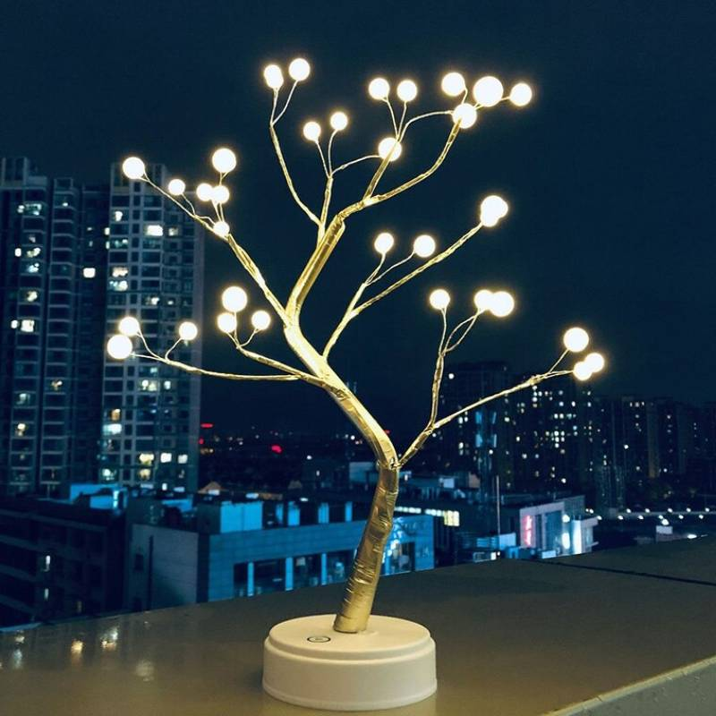 Decorative table lamp pearl tree beside window