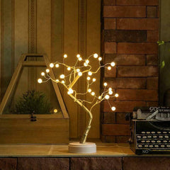 Pearl Tree table lamp shining on a rustic table