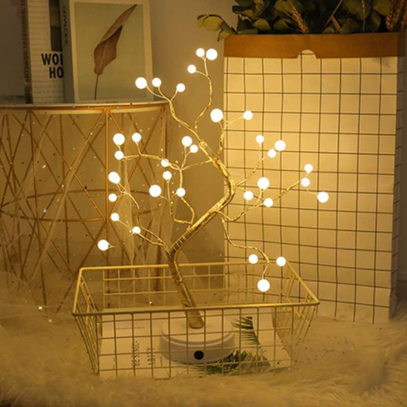 Decorative table lamp with fairy lights pearl tree on the floor in basket