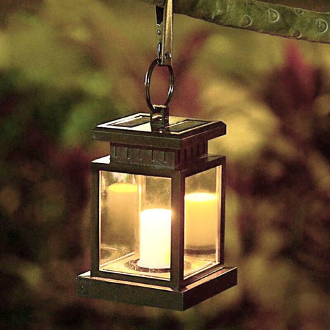 Neo Glim Solar Flameless Candle Lantern hung on tree in autumn