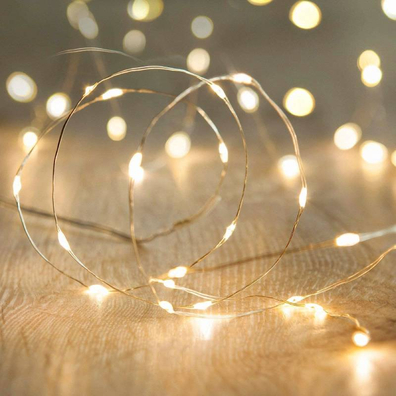 Starlit Gold LED String Light Close Up Shot On the wooden table